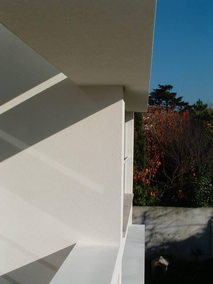 Casa Melo: Terraços  por Lousinha Arquitectos