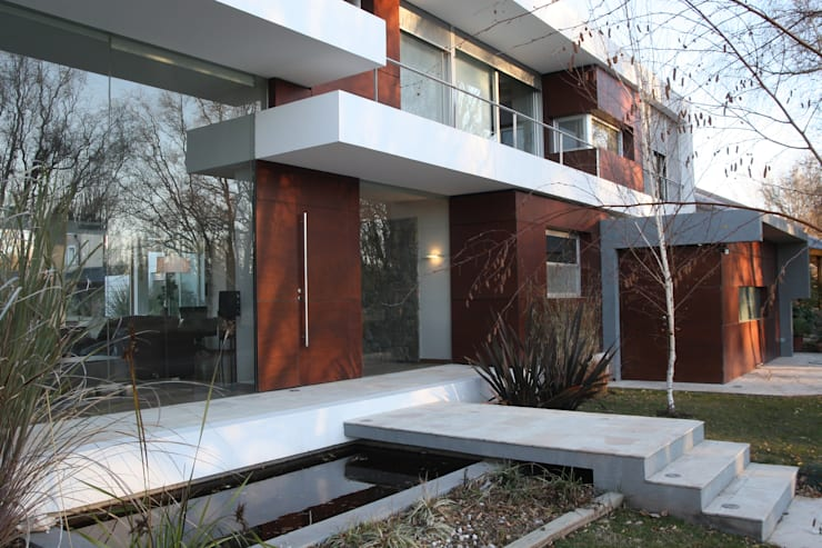 VISTA FRENTE 04: Casas de estilo  por Poggi Schmit Arquitectura