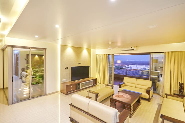 Tv unit :  Living room by iSTUDIO Architecture