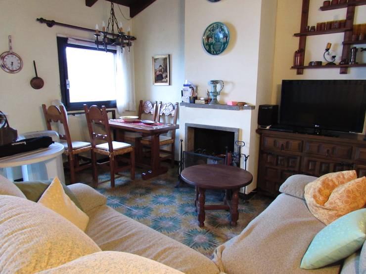 Appartamento in vendita sul Lago Maggiore: Case in stile  di Boite Maison