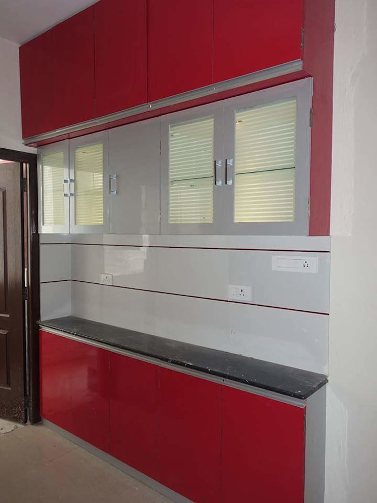 Kitchen & Wadrobes: country  by Womenz Modular Designers Private Limited,Country Plywood