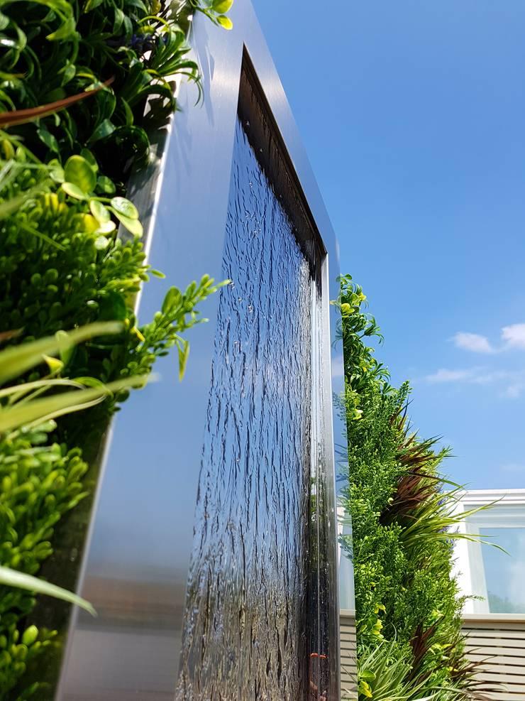 South Kensington roof terrace:  Terrace by Paul Newman Landscapes