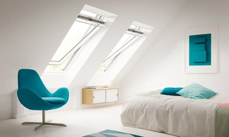 Sottotetto: Camera da letto in stile  di Tucommit