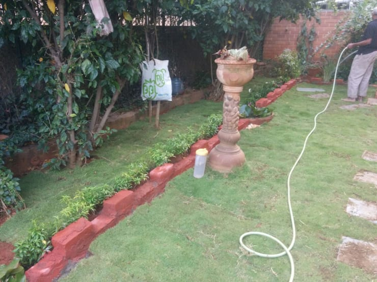 Mrs. Ganga's Private Residence:  Garden by Cherry Garden and Landscapers,Classic