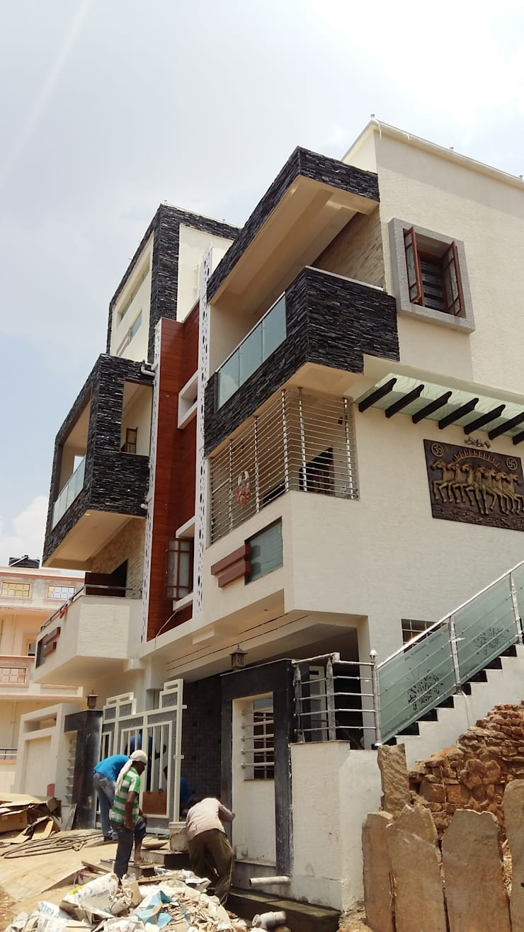 Residence at Bangalore:  Houses by Cutting Edge Architects,Modern Engineered Wood Transparent