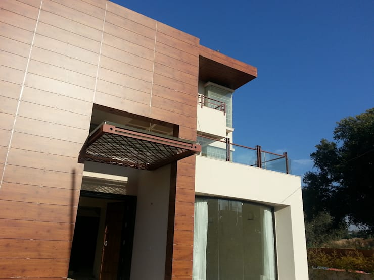 Exterior Massing: eclectic Houses by NOOR Architects Consultants