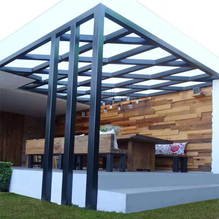 Jardín : Jardín de estilo  por Arquitectos M253