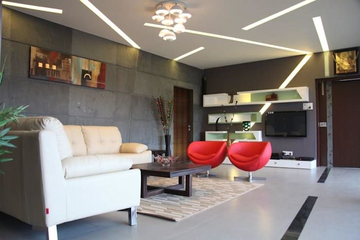 pent house for Mr. Jahagirdar At nanded:  Living room by 4th axis design studio