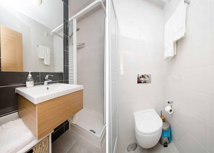 Interior Design Project - Apartment Albufeira: Casa de banho  por Simple Taste Interiors
