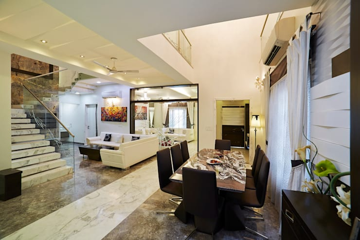 SADHWANI BUNGALOW:  Dining room by Square 9 Designs