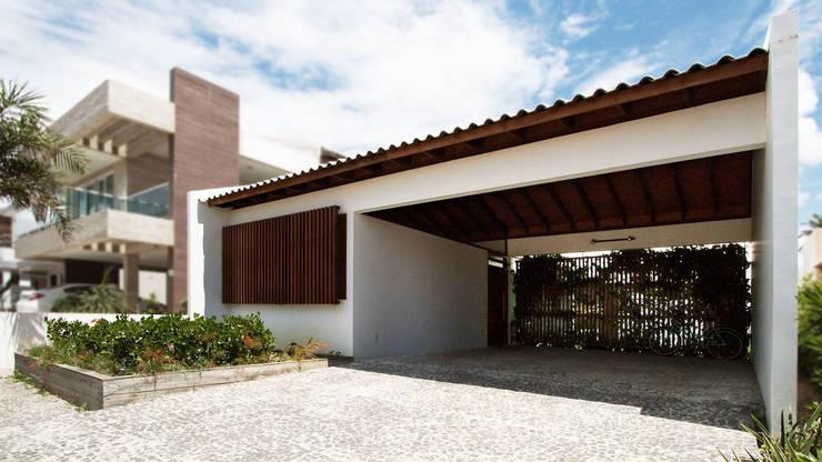 Casas de estilo  por Coletivo de Arquitetos