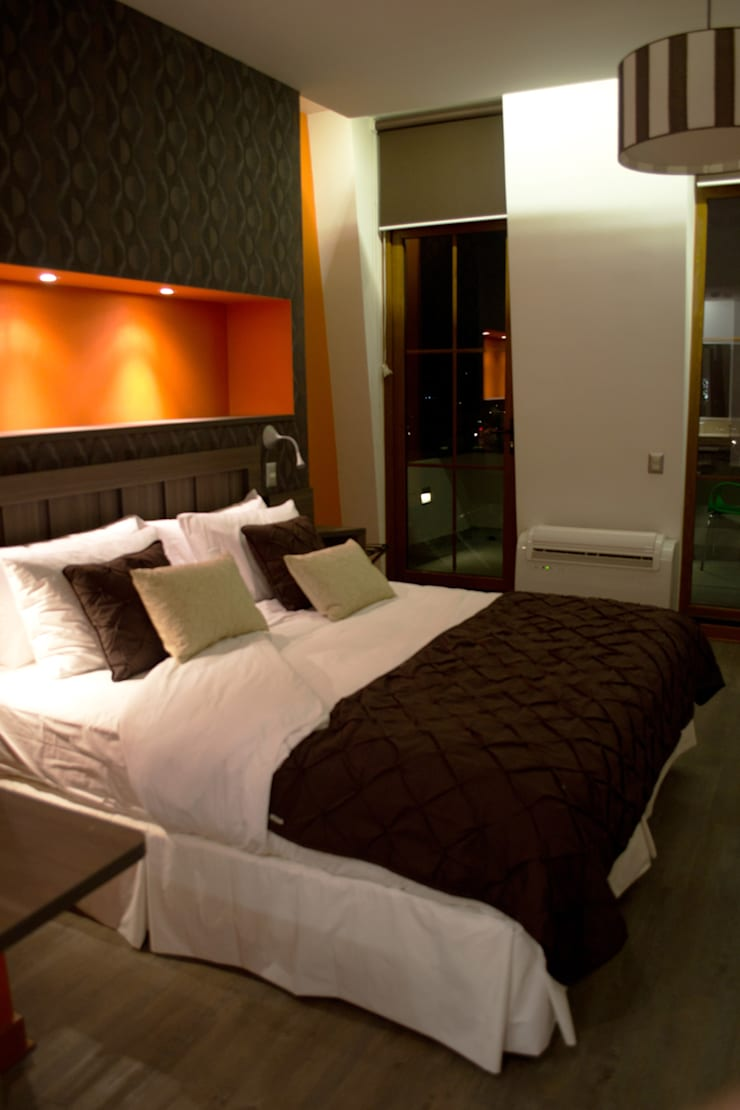 Hotel Boutique Su Merced: Dormitorios de estilo moderno por EARQ
