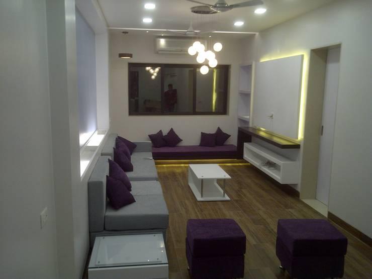 living room:   by VUE DESIGN