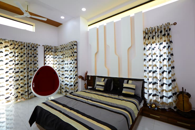 Dr Rafique Mawani's Residence:  Bedroom by M B M architects