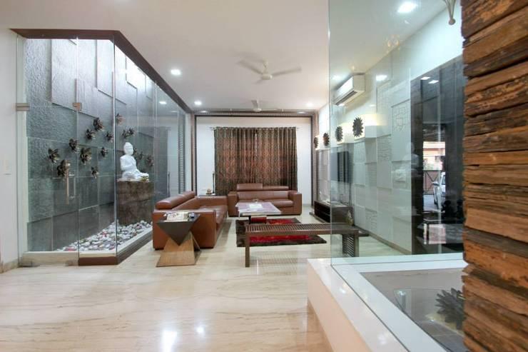 Living room:  Living room by Interior Shapes & Designs,Modern