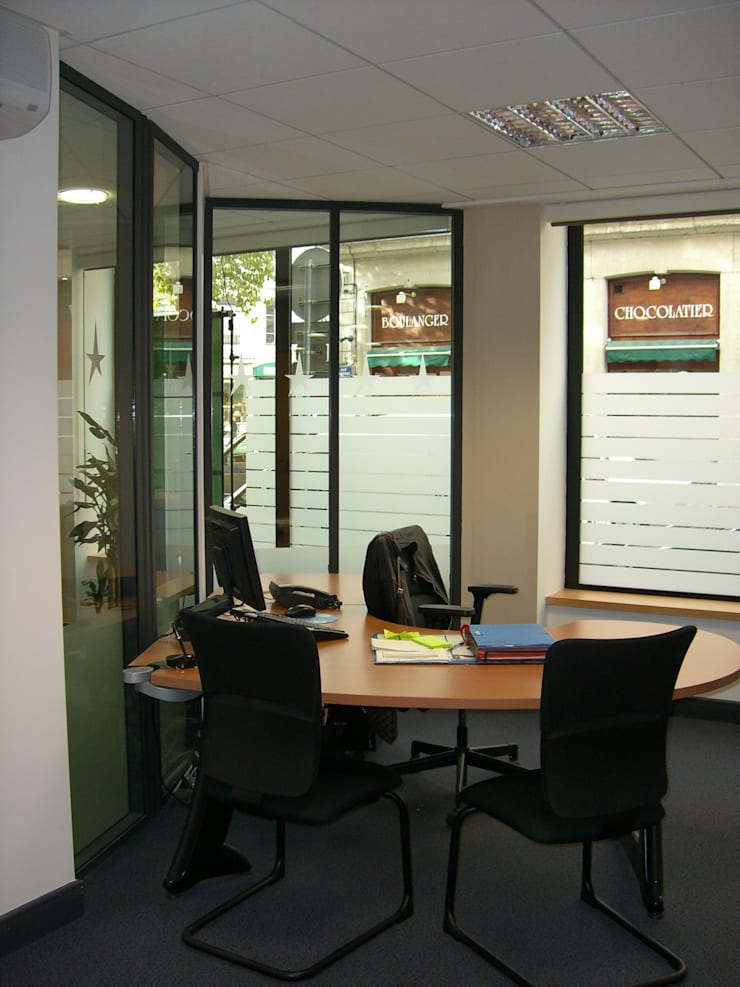 Bureau de conseiller: Bureaux de style  par Pierre Bernard Création,