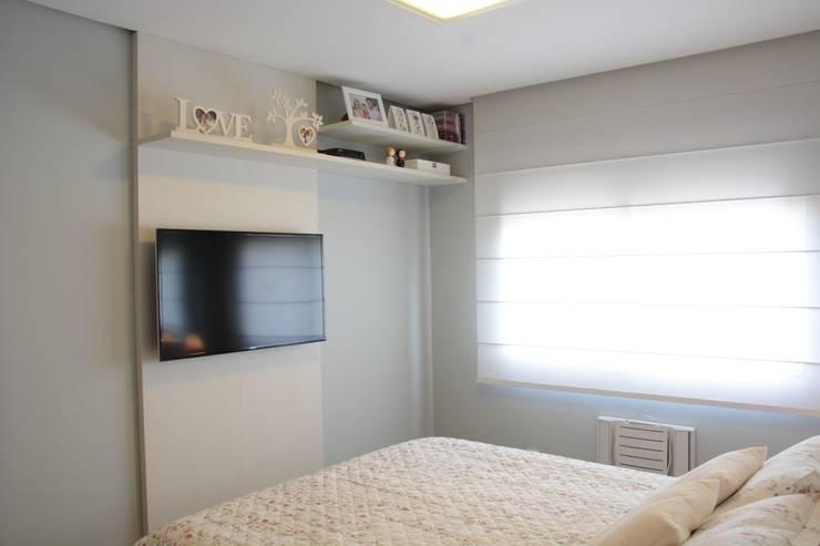 Camera da letto in stile  di Expace - espaços e experiências