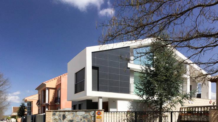 Casas de estilo  por arqubo arquitectos