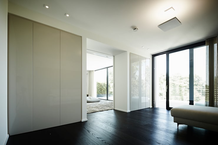 Salas de estilo  por Bauer Schranksysteme GmbH