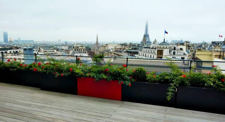Balcon, Veranda & Terrasse de style  par homify