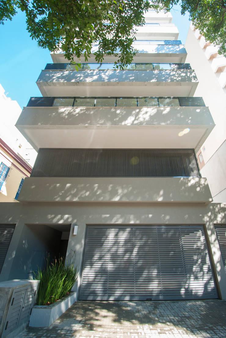 Houses by Tato Bittencourt Arquitetos Associados, Modern