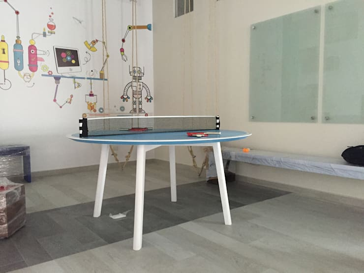 Mesa Recreativa ping pong: Oficinas y tiendas de estilo  por Herm & Bleu