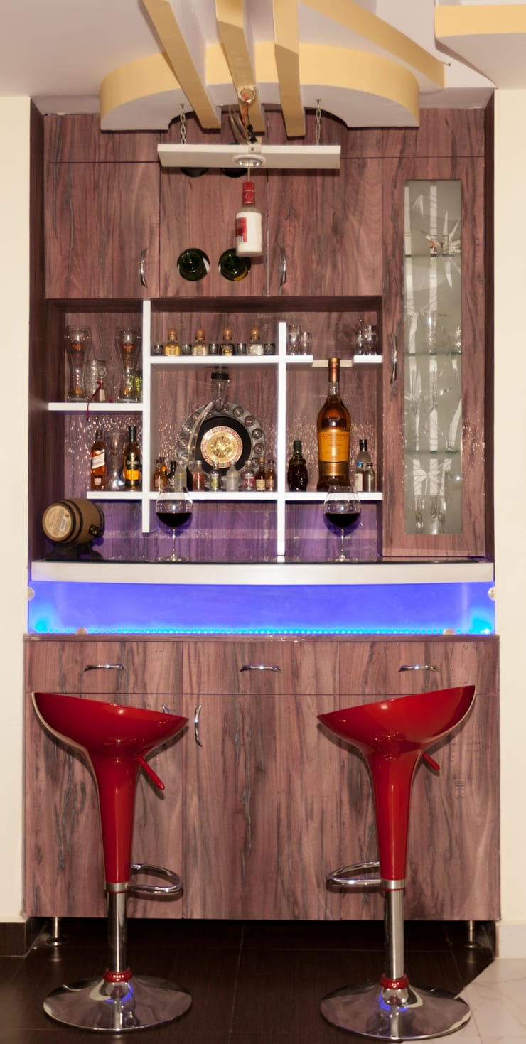 bar counter:  Living room by Kriyartive Interior Design
