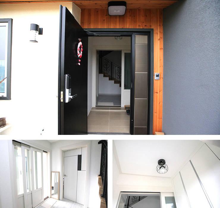 실용적인 아이디어가 돋보이는 모던스타일 전원주택[충남 천안]: 지성하우징의  복도 & 현관,모던