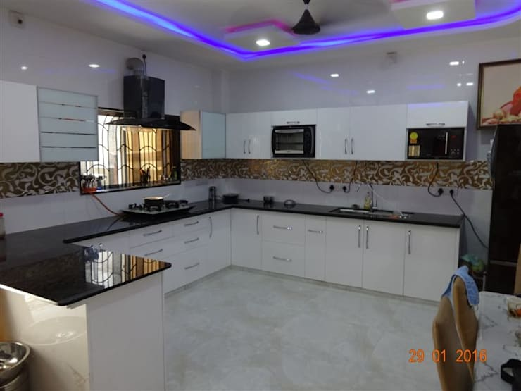 high gloss white hdf material  :  Kitchen by aashita modular kitchen
