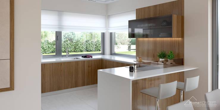 Cocinas de estilo moderno por HomeKONCEPT   Projekty Domów Nowoczesnych