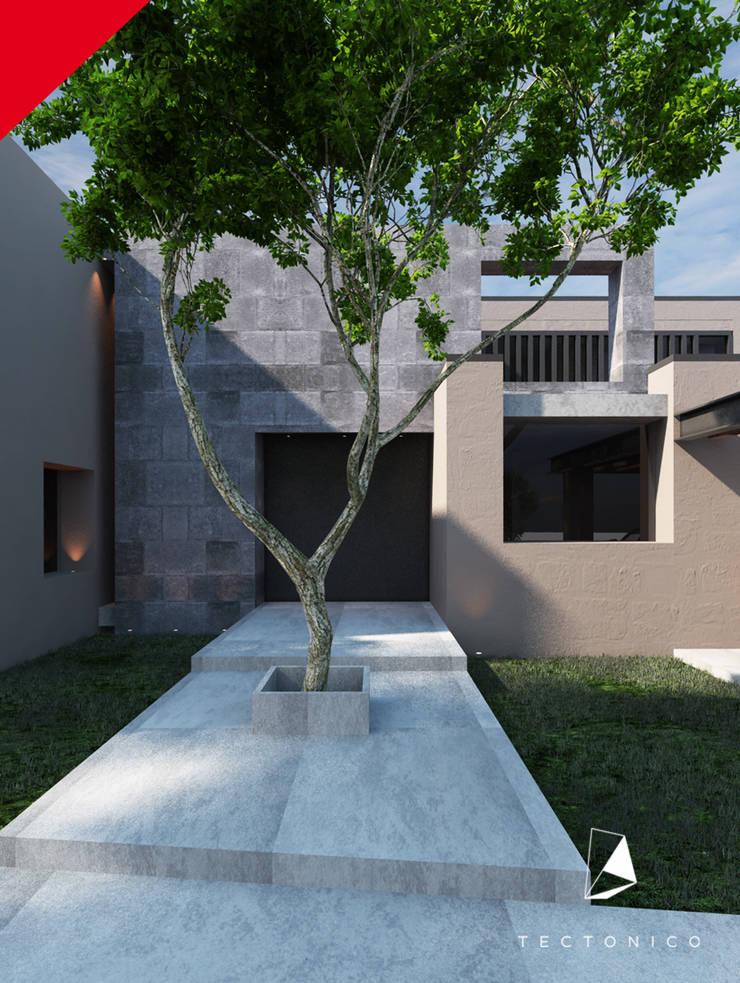 CASA CELAYA: Casas de estilo  por Tectónico