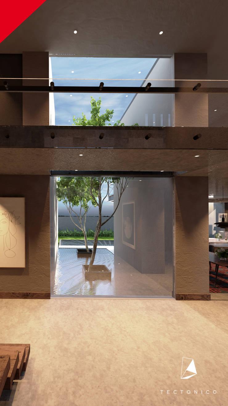 CASA CELAYA: Pasillos y recibidores de estilo  por Tectónico
