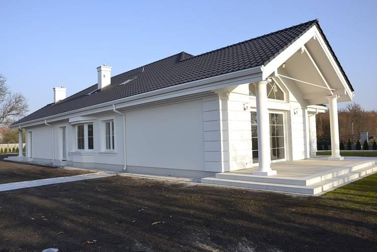 Rezydencja Parkowa: styl , w kategorii Domy zaprojektowany przez MG Projekt Projekty Domów