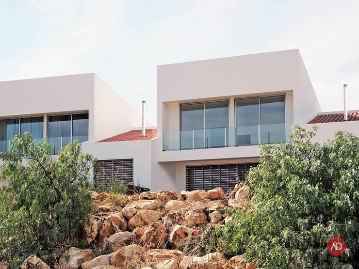 Moradias Unifamiliares: Casas  por ARCHDESIGN | LX