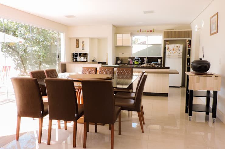Dining room by Cecyn Arquitetura + Design,