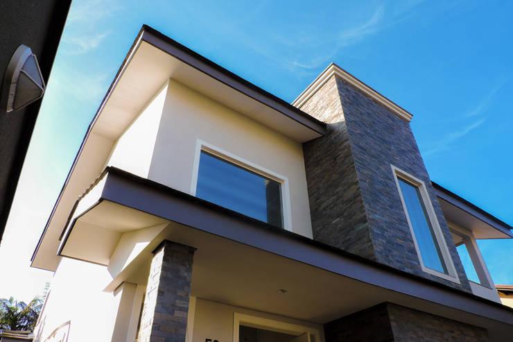 บ้านและที่อยู่อาศัย by Cecyn Arquitetura + Design