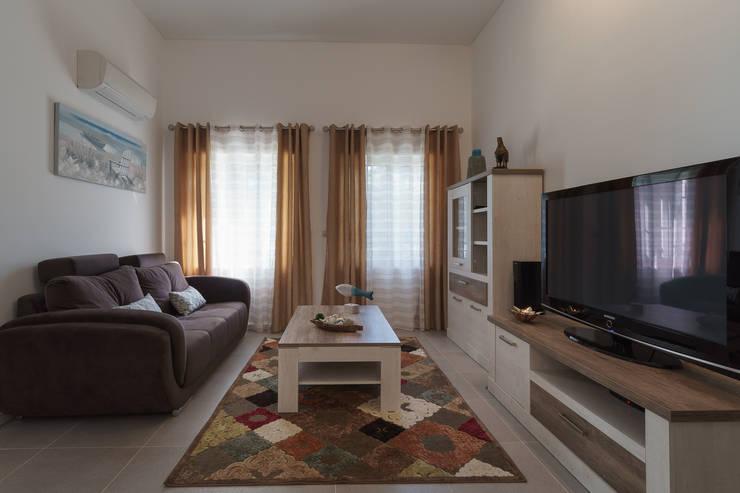 Vale Garrão: Salas de estar  por Zenaida Lima Fotografia