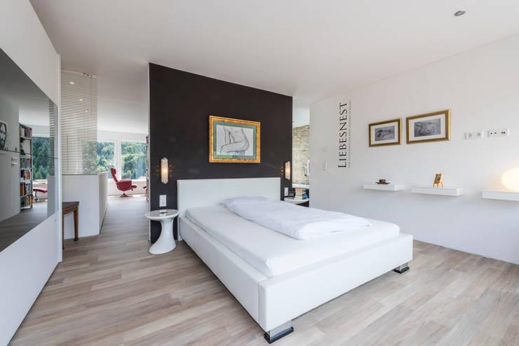 Projekty,  Sypialnia zaprojektowane przez KitzlingerHaus GmbH & Co. KG