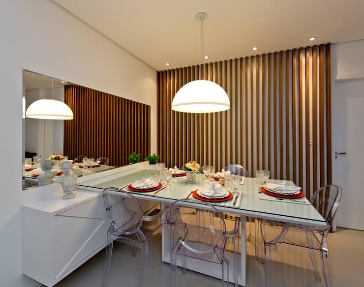 Comedores de estilo industrial por Mendonça Pinheiro Interiores