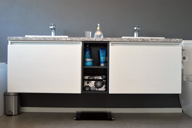 LC Interiors:  Bathroom by Capital Kitchens cc