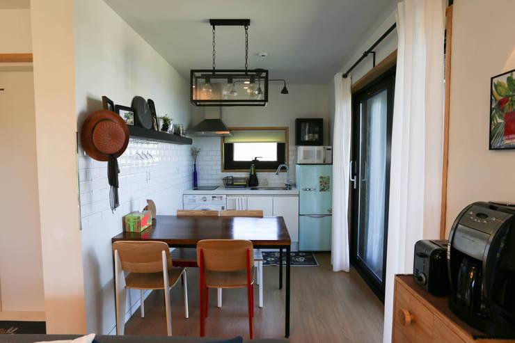 Cocinas de estilo asiático por 아키제주 건축사사무소