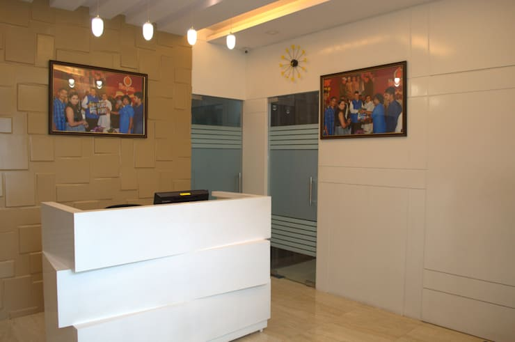 Reception Area:  Commercial Spaces by Olive Roof