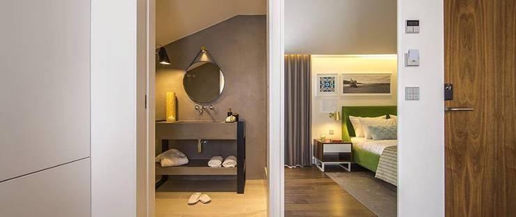 Casa de Banho / Parede de Quarto em Microcimento: Hotéis  por 4Udecor Microcimento