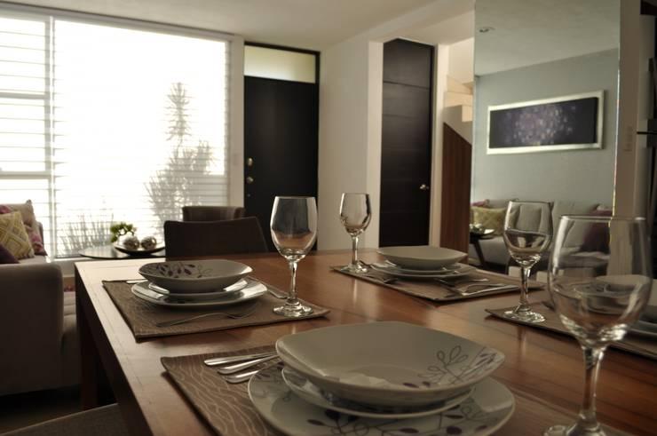 Casa Giralda: Comedor de estilo  por Dovela Interiorismo