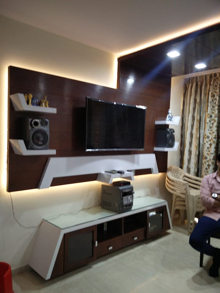 Tv unit in living hall:  Living room by Shape Interiors,Modern