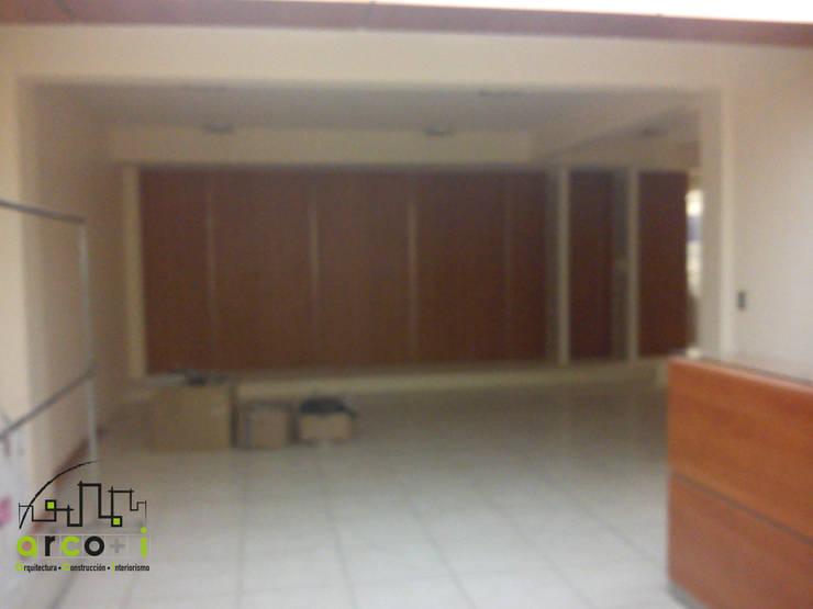 Oficinas Administrativas: Oficinas y tiendas de estilo  por ARCO +I