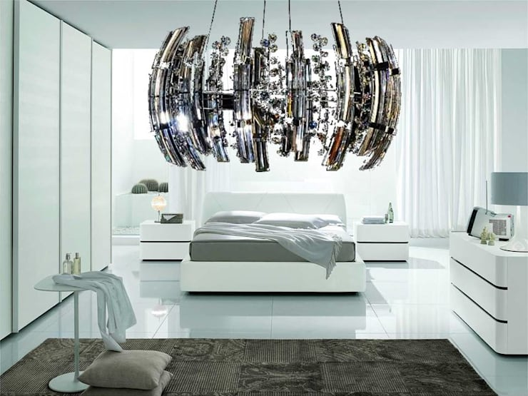 Iluminacion Strass: Dormitorios de estilo  por Goldencris