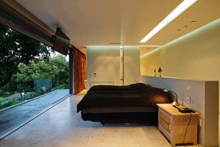 Incredible modern house in the heart of Ballito:  Bedroom by CA Architects