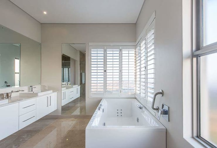 Simple yet beautiful home in Brettenwood:  Bathroom by CA Architects