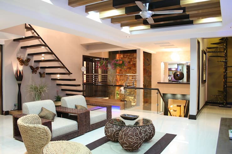 tropical Living room by Design Spirits